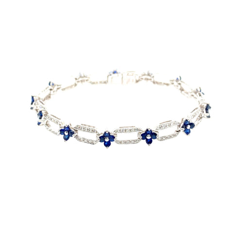 Dress to impress with this gorgeous 14 Karat White Gold Open Link Sapphire and Diamond Bracelet. With 52 Blue Sapphires and 130 Diamonds, this 11.6 Gram Bracelet will sparkle with every move.  Length is 7