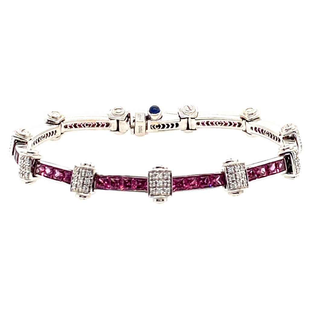 Pretty in Pink with this Estate Bracelet. This 18 Karat White Gold Charriol Flamme Blanche Bracelet Channels in 5.2ctw of Pink Sapphires and 2.97ctw of VS Diamonds. The Custom made Clasp includes a hidden safety.   Length is 7
