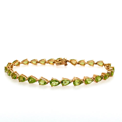 This 10 Karat Yellow Gold Estate Bracelets Features Pear Shaped Peridot Gemstones. The Clasp Contains a Safety 8 for Added Security. the Bracelet Length is 7 1/2