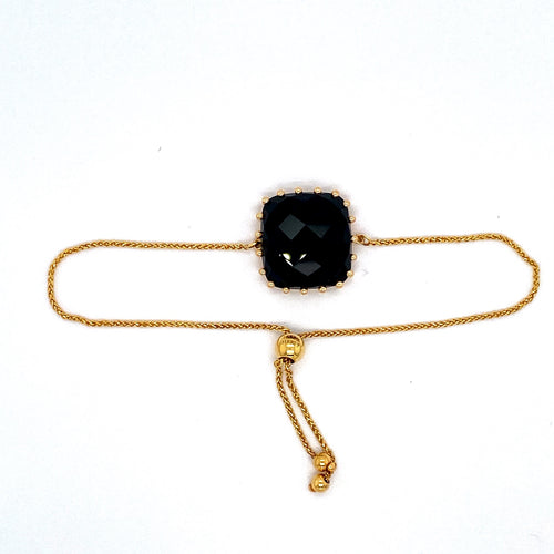 This Beautiful Checkerboard Cut Black Onyx is Prong Set in this 14 Karat Yellow adjustable Bracelet.