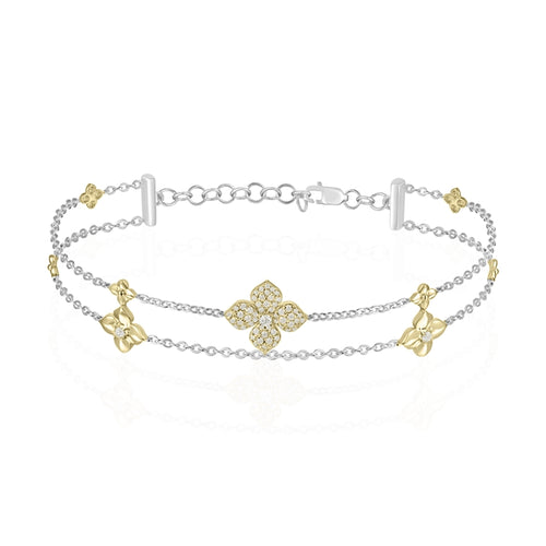 14 karat white gold and yellow gold diamond bracelet with a flower motif design.  .22 diamond total weight  adjustable from 7