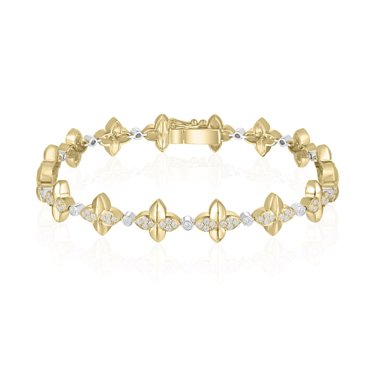 14 karat yellow gold bracelet with 1.12 carat total weight of diamonds and measures seven inches in length