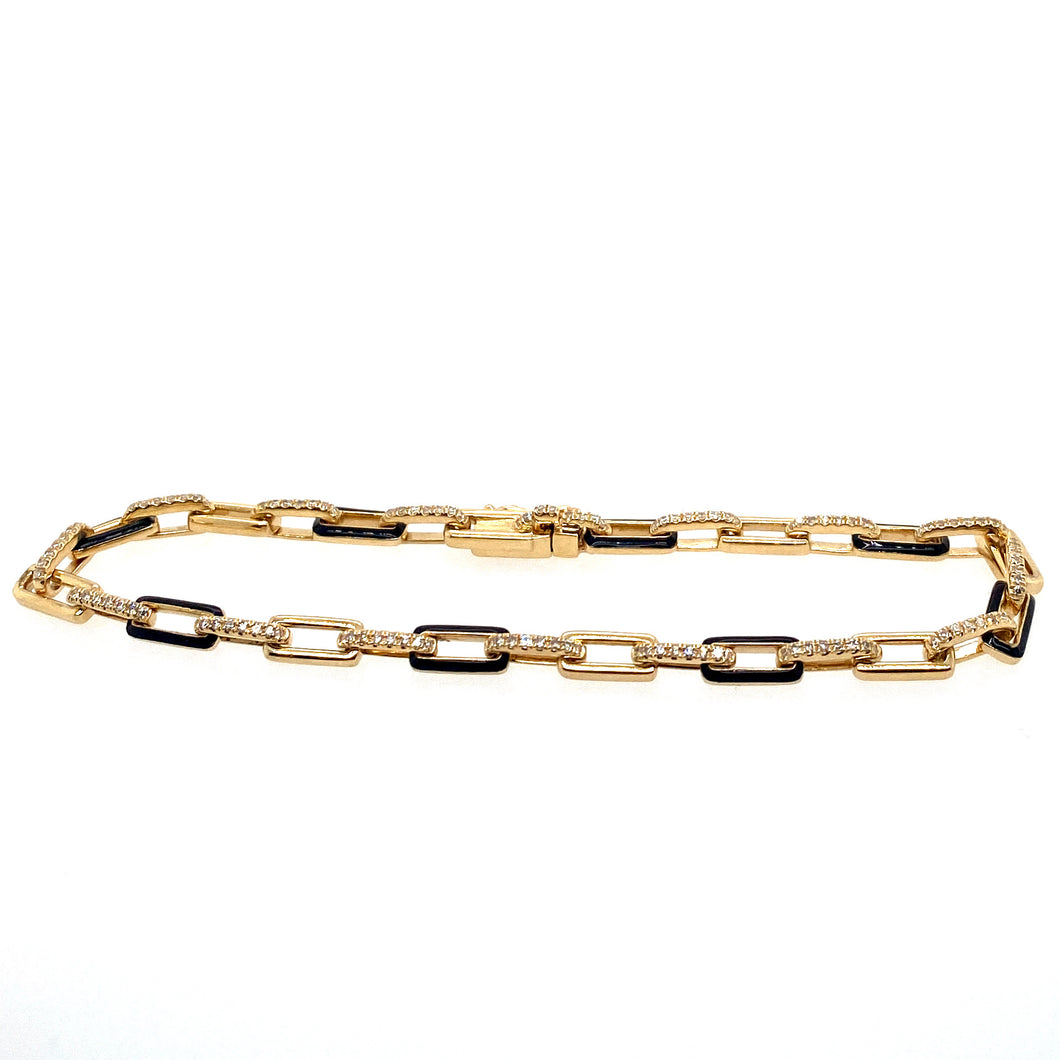 This 14 Karat Yellow Gold Bracelet, designed by Luvente, Features Yellow Gold Links with Black Enamel in Between Yellow Gold Links set with Round White Diamonds. The Bracelet has a Safety Eight for Added Security.  Total Diamond Weight = 1.35 Carats  Total Length = 7