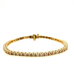 "This 14 Karat Yellow Gold Tennis Bracelet Features 4.00 Total Carats of Diamonds. A Fold-over Hidden Safety Provides Extra Security.  Total Length is 7""  Total Weight is 14.2 Grams"