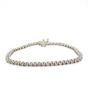 "This 14 Karat White Gold Bracelet Holds 60 Round Diamonds for a Total Weight of 2.49 Carats. The Bracelet has a Hidden Safety for Added Protection.  Total Length is 7""  Total Weight is 10.5 Grams  Estate Bracelet - all weights are approximate"