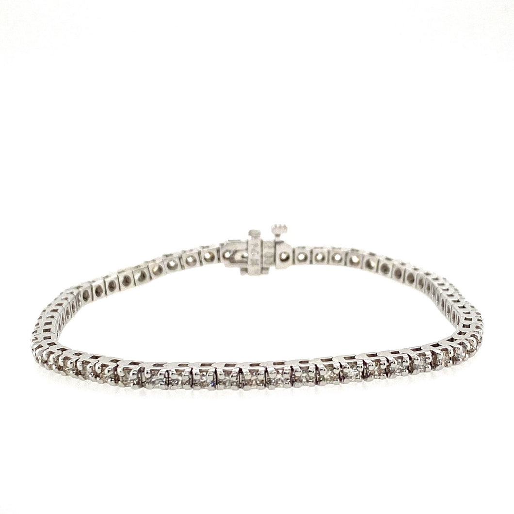 This 14 Karat White Gold Bracelet Holds 60 Round Diamonds for a Total Weight of 2.49 Carats. The Bracelet has a Hidden Safety for Added Protection.  Total Length is 7