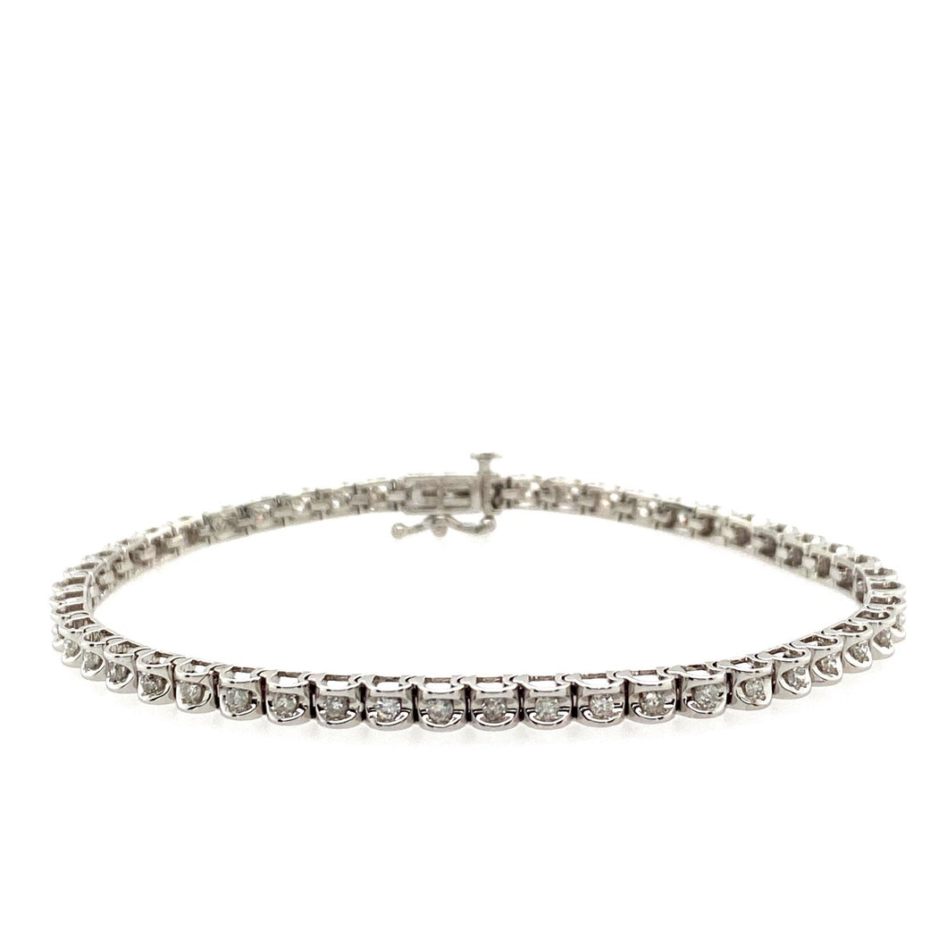 This 14 Karat White Gold Tennis Bracelet is Designed with a Smooth Finish, where 1.00dtw of Sparkling Diamonds are Set into it. The Clasp has Extra Security with a Safety 8.  Total Length is 7 1/4