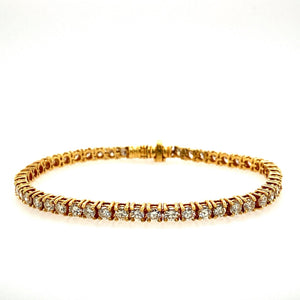 "This Beautiful Tennis Bracelet has Approximately 5.00 Carats Total Weight of High Quality Brilliant-Cut Diamonds set into Luxurious 18 Karat Yellow Gold. A Hidden Safety is Provided for Extra Security.  Total Length is 7""  Diamond Total Weight Approximately 5.00 Carats (VS-2 with I-J Color)  Estate Bracelet - all Weights are Approximate"