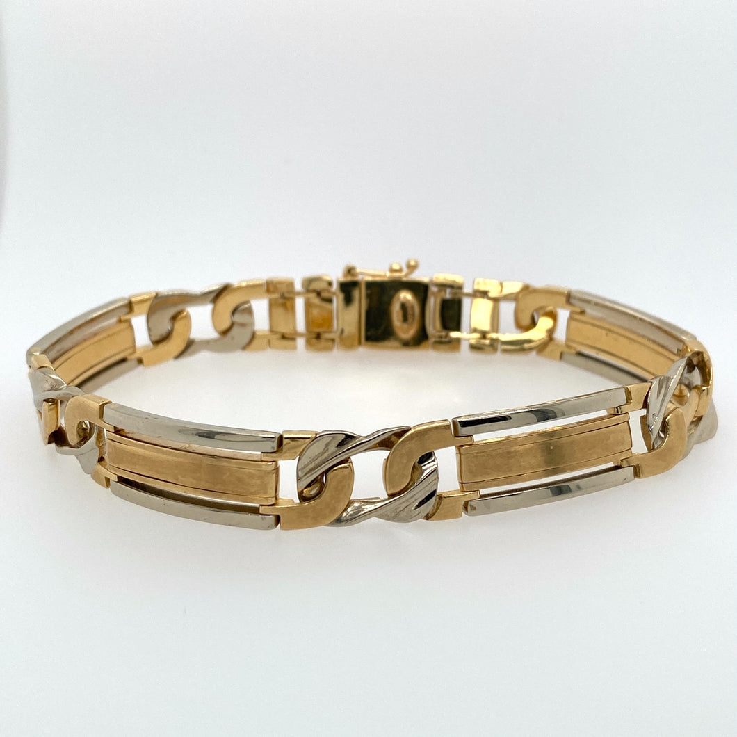 One of Our Favorites, this Men's Link Bracelet features White Gold and Yellow Gold. the Push in Clasp also has an Additional Safety for Added Security.  Width 10.0mm  Total Weight 28.9 Grams  Length 8