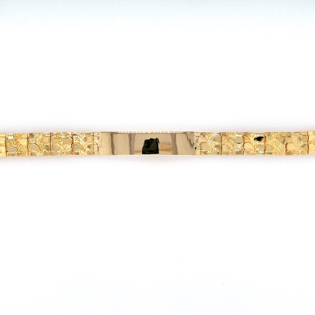 This 14 Karat Yellow Gold Nugget Style Bracelet Features an ID Plate For Engraving. The Bracelet is Secured with a Fold Over Clasp.  Width 9.8mm  Length 8 1/4
