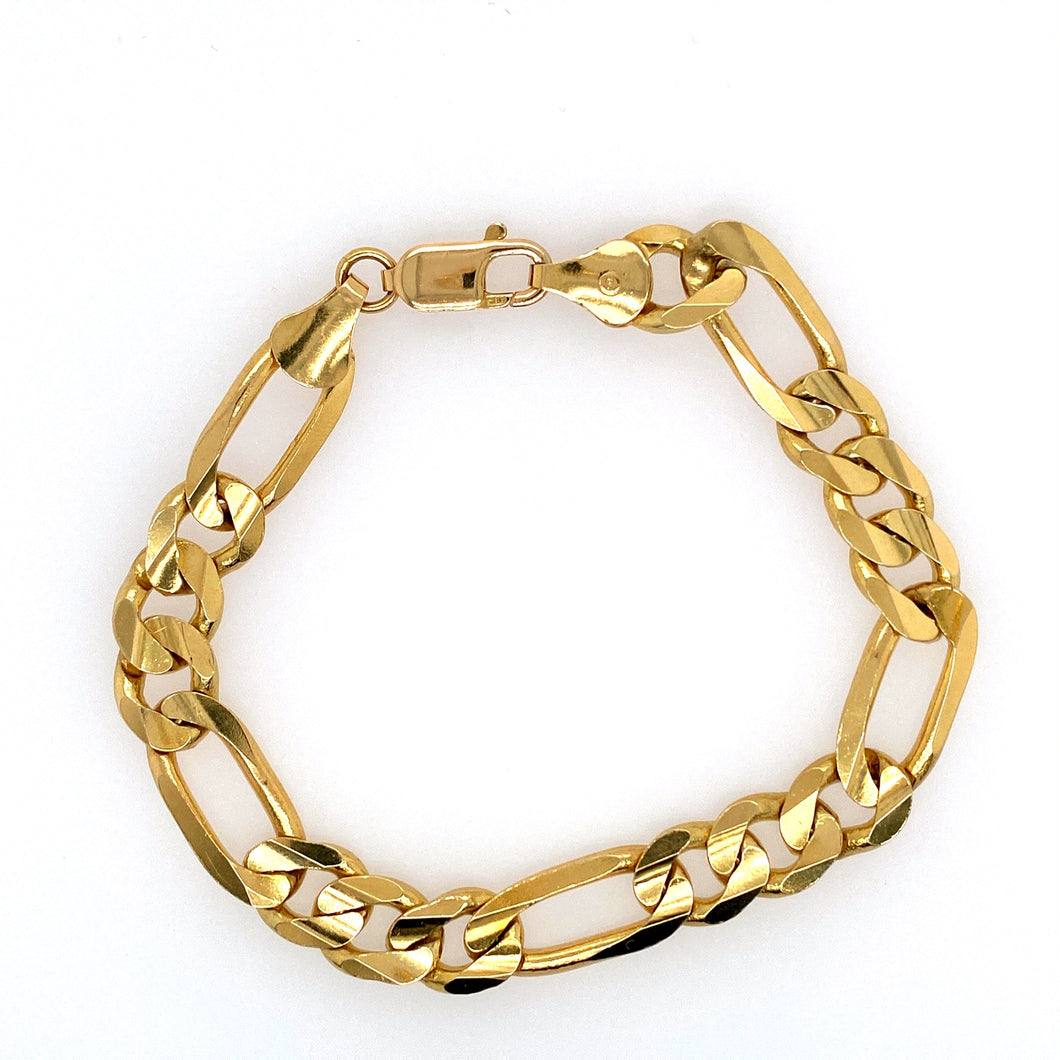 This 14 Karat Yellow Gold Bracelet Features Figaro Links, and is Secured with a Lobster Clasp.  Width 9.8mm  Weight 30.6 Grams  Length 8 1/2