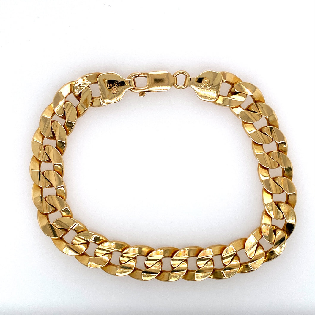 This Men's 14 Karat Yellow Gold Curb Bracelet is Secured with a Lobster Clasp.  Width 10.6mm  Total Weight 40.8 Grams  Total Length 8 3/4