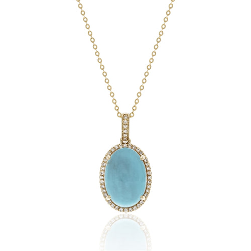 A favorite combination- turquoise and yellow gold! Featuring a 6.48 carat turquoise gemstone surrounded by .13 carats of diamonds in 14 karat yellow gold.  Chain is Adjustable to 18