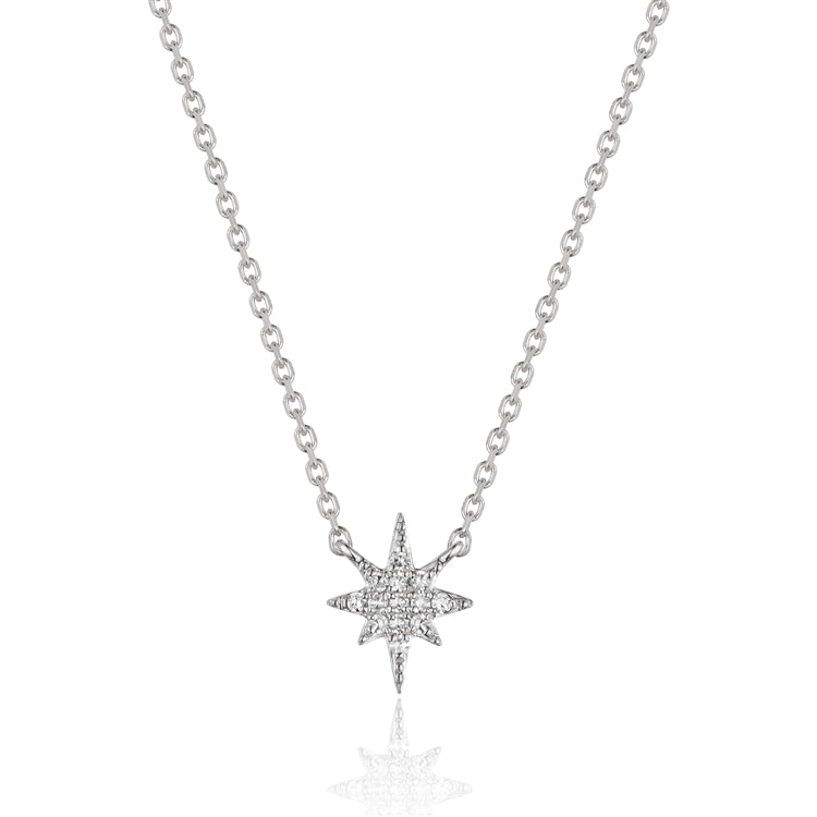 This Dainty 14 Karat White Gold Stationary Link Necklace Features 13 Round Diamonds set into a Star Shaped Setting. The Necklace Measures 16