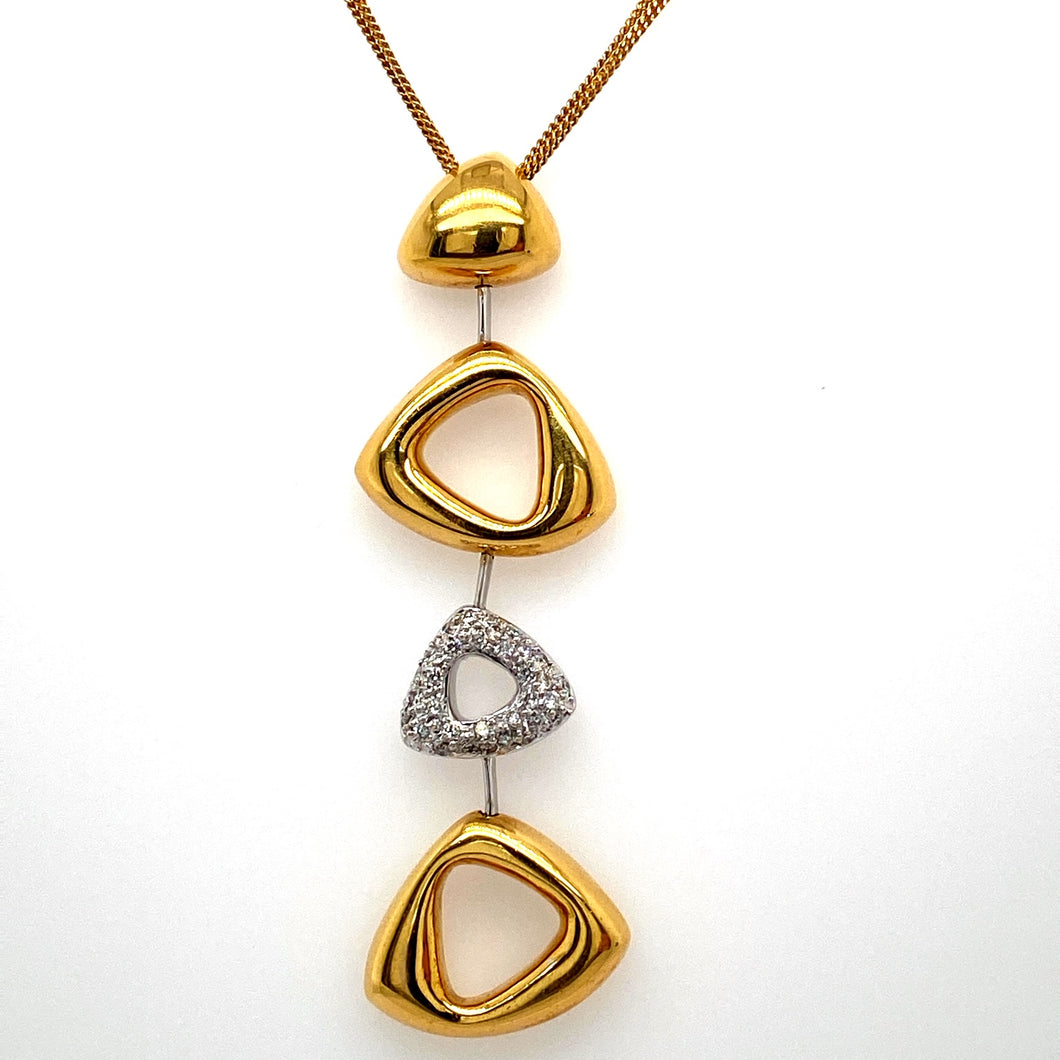 This Gorgeous 18 Karat Yellow Gold and White Gold Geometrical Necklace Designed by Cherie Dori Features a Two and a Quarter Inch Long Drop with High Polished 18 Karat Yellow Gold Triangular Shaped Settings and a Triangular Shaped Pave Diamond Setting. The Drop is Hung by a Three Strand 18 Karat Yellow Gold 17