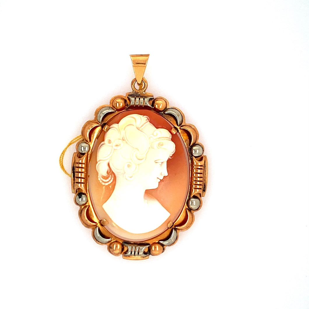 This Pretty Estate Pendant Features a 14 Karat Rose Gold and White Gold Uniquely Designed Pendant Mounting Holding an Oval Shaped Cameo of a Lady.   Measures Approximately 45.0mm x 37.0mm  Total Weight 13.7 Grams