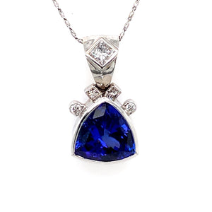 This 9.00 Carat Violet Blue Trillion Cut Tanzanite Gemstone is Bezled in to High Polished 18 Karat White Gold Pendant featuring a .45 Carat Princess-Cut Diamond in the Bail and 4 Round Diamonds Totaling .35dtw above the Gemstone.