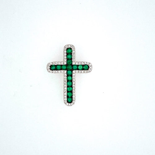 One of our Favorite Emerald Pieces, this 14 Karat White Gold Cross Features 16 Round Emerald Gemstones set into the Cross, Surrounded by a diamond Halo The Cross Features a Hidden bail in the back to run your chain through. Cross Measures Approximately 21.0mm x 16.0mm  Total Diamond Weight .21 Carat