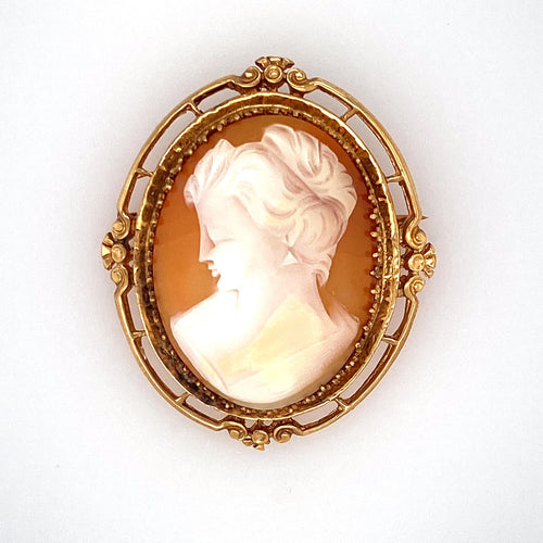 The Design of this Estate 14 Karat Yellow Gold Mounting Holding a Cameo of a Lady is One you might have Seen Your Grandma Wear. This Beautiful Cameo can Be worn as a Pin or a Pendant. Measures Approximately 47.0mm x 40.0mm  Total Weight 13.5 Grams