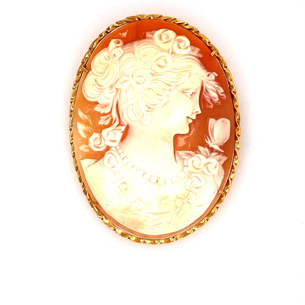 This Gorgeous Large Cameo of a Lady Estate Piece can Be Worn as a Pin or a Pendant. The Cameo is Set into a Oval Twisted Design Mounting. Measures Approximately 62.0mm x 47.0mm  Total Weight 19.5 Grams. Made in 18 Karat Yellow Gold