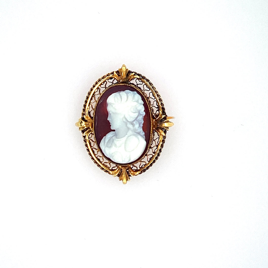 This Pretty Little Estate Cameo can be Worn as a Pin or a Pendant. Beautiful Detail in the 14 Karat Mounting featuring a Leaf Design at the Top and Bottom of the Pendant, as Well as Each Side. Measures Approximately 27.0mm x 22.0mm  Total Weight 5.6 Grams