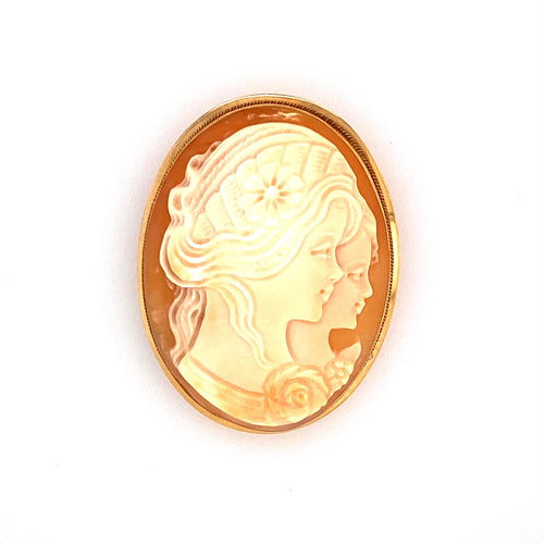 This Estate 14 Karat Yellow Gold Cameo can be Worn as A Pin or a Pendant. The Oval Cameo Features Two Ladies Faces, Encased into a 14 Karat Yellow Gold Mounting. Measures Approximately 41.0mm x 31.0mm  Total Weight 7.6 Grams