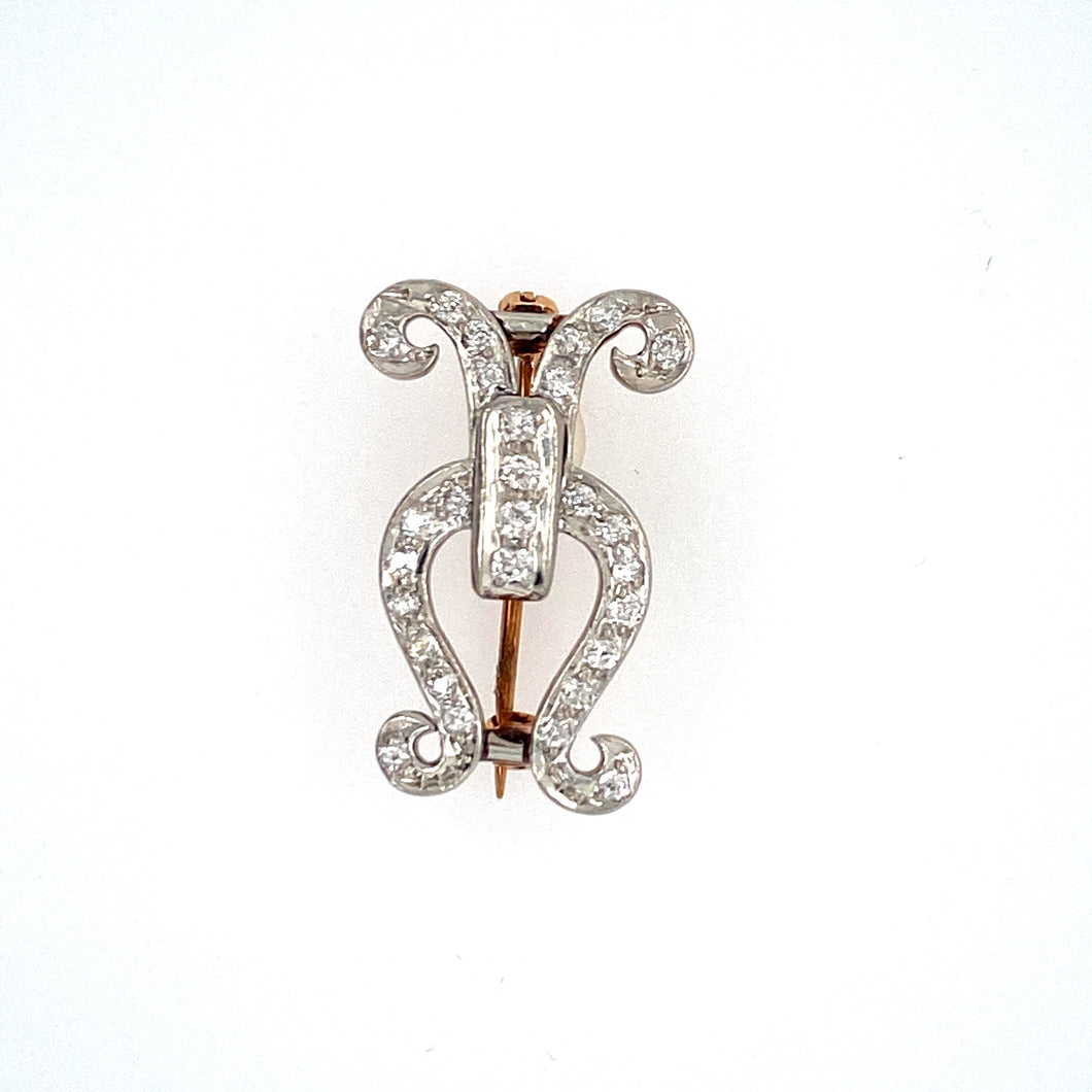 This 14 Karat Estate Pin Features a Freeform Design in all White Gold with 28 Diamonds set Throughout, and Secured with a Yellow Gold Pin in the Back. Measures Approximately 25.0mm x 14.0mm  Total Weight 4.6 Grams
