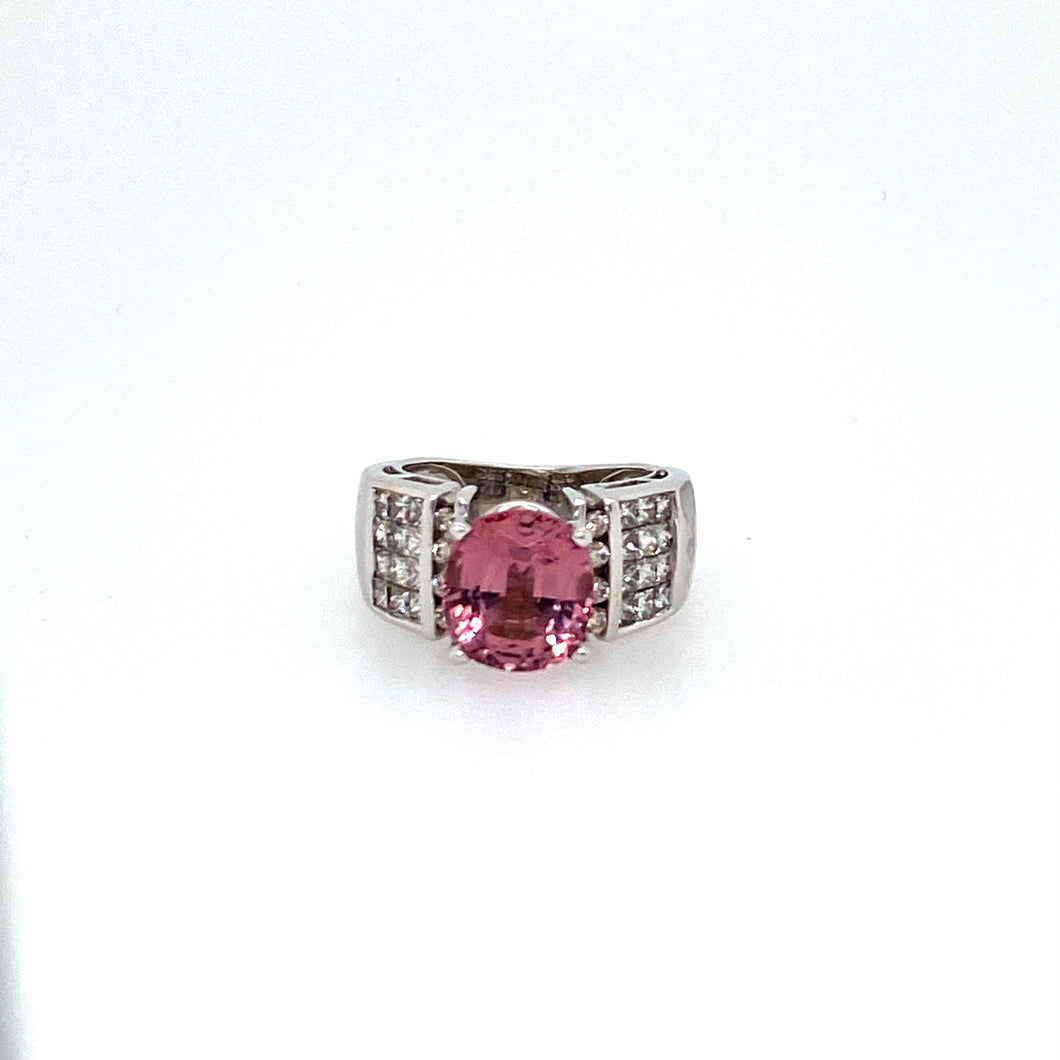 If your a fan of Fine Pink Gems, Spinel is an Excellent choice. This Beautiful Round Spinel Gemstone is features with 3 Rows of Princess Cut Diamonds down Both Sides.  Total Diamond Weight is Approxmately .97dtw  Total Weight is 7.9 Grams  Finger size 4.5