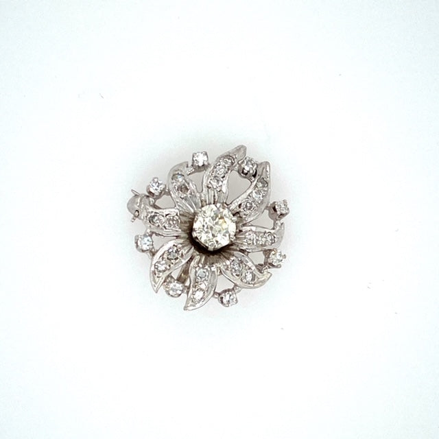 Can Wear this as a Pin or Pendant, this Platinum Estate Pin Features a Flower Top Design with a .60 Carat Round Ole European-Cut Diamond in the Center with Single Cut Diamonds all Around the Top of the Pin. Total Weight 4.3 Grams  Measures Approximately 20.0mm  Diamond Weight is Estimated