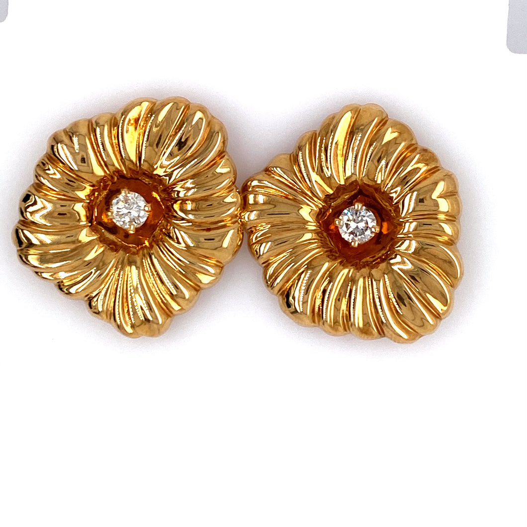This Pretty Pair of Estate Earrings Feature a Large Ribbed High Polished Flower Shape Holding a .25 Carat Round Diamond in the Center.  Approximate Total Diamond Weight = .50 Carat
