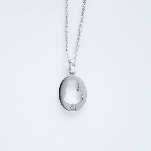 mommy chic sterling silver cut-out heart round disc necklace.  chain can be worn at 18