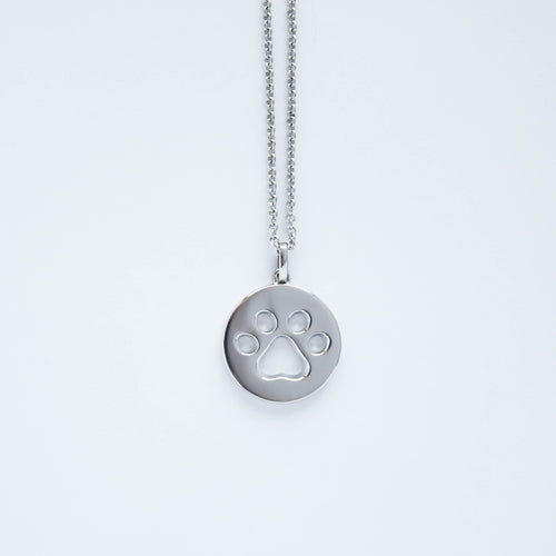 mommy chic sterling silver cut-out paw print necklace that can be worn at 18