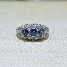 Load image into Gallery viewer, Blue, Bold and Beautiful Best Describes this Platinum Filigree Designed Three Sapphire Ring Accented with Approximately .50 Carats of Old European-Cut Diamonds.  Finger Size is 7.  This is an Estate Ring