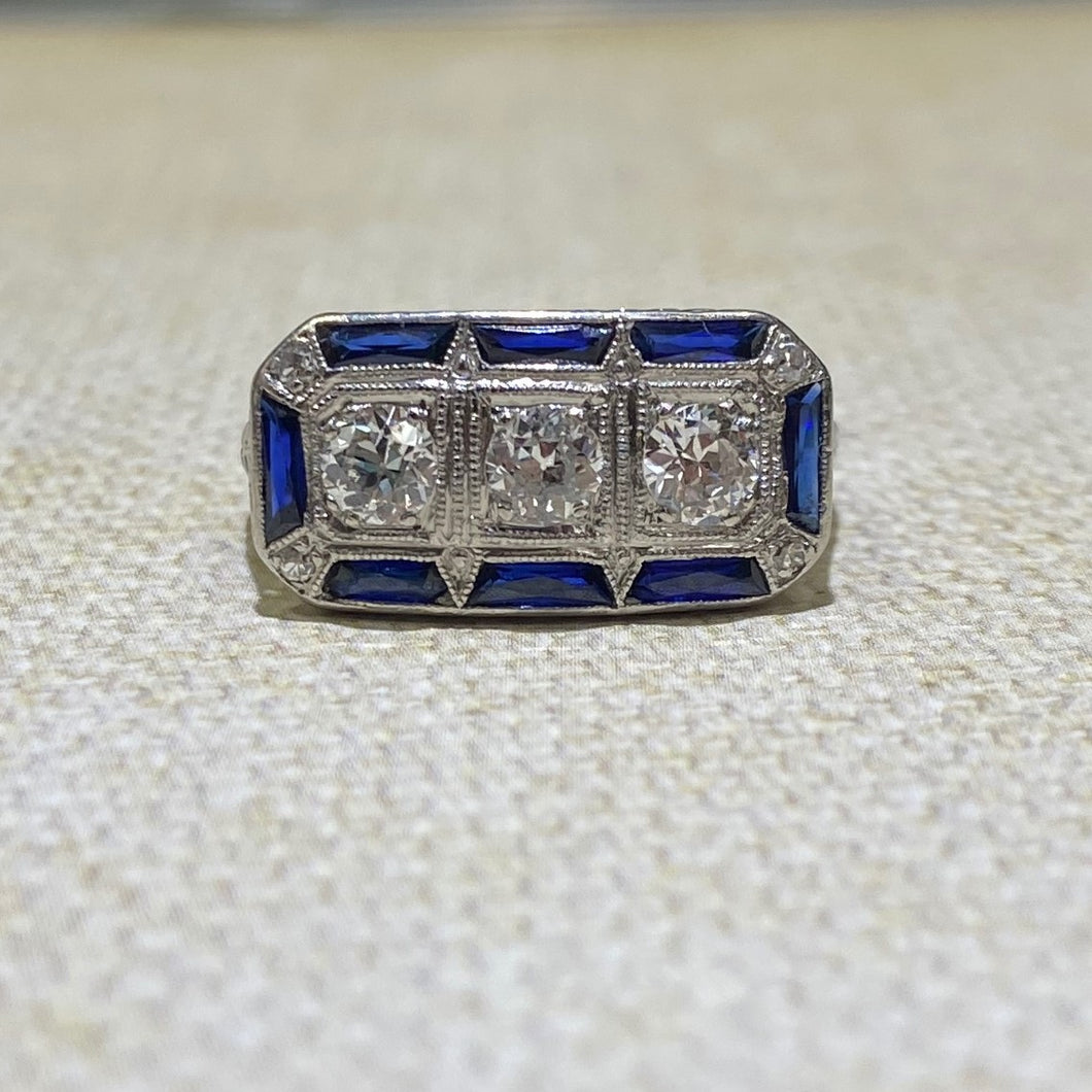 Platinum Elongated .70 Carat Weight (approximate) and Sapphire Estate Ring.  Finger Size is 6.25