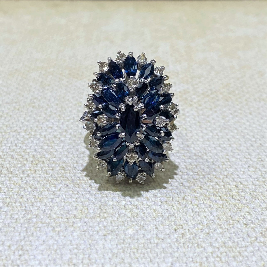 18 Karat White Gold Marquis Sapphire and dimaond Cluster Cocktail ring.  the Total Gram Weight is 12.9.  Diamond Weight is .60 Carat.  Finger Size is 7
