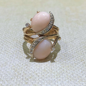 Estate 14 Karat Yellow Gold Two Coral Cabochon-Cut ring with an added touch of accent diamonds to this freeform ring. Finger Size is 7.5. Total Weight is 12.3 Grams