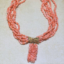 Load image into Gallery viewer, Add a pop of Color to your summer wardrobe with this 14 Karat Yellow Gold Six Strand Coral Necklace with a Carved Coral Pendant Dangling from the Center.