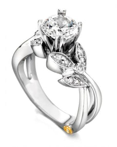 "14 Karat White Gold ""Mystic"" Engagement Ring designed by Mark Scneider, contains 15 diamonds totaling .145 carat. the Center stone is not included in the price and is sold separately. Finger size is 6.5"