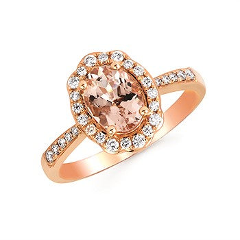 14 Karat Rose Gold Morganite ring with .25 Carat total weight of diamond accents. Finger size is  6.5s