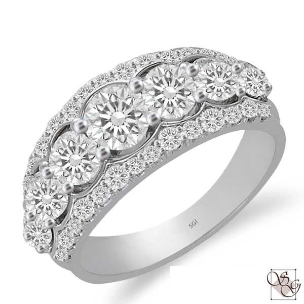 This gorgeous 14 Karat White Gold Wide Wedding Band has a total weight of .44 carat of diamonds down both outside edges of the ring. The Band is waiting for your choice of 7 graduated stones (not included in price, sold separately).  The 7 center stones are sold separate;y, not included in price  Finger size is 6