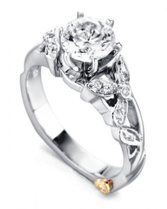 "14 Karat White Gold ""ADore"" engagement ring, designed by Mark Schneider, contains 17 diamonds totaling .085 carat. The  1 Carat Center round stone is sold separately and is not included in the price. The finger size is 6.5"