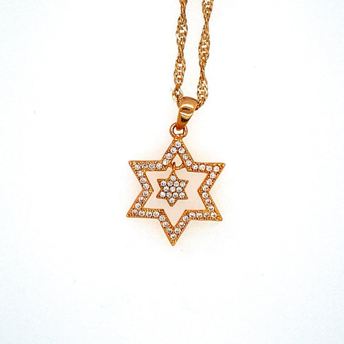 This Sterling Silver and Yellow Gold Plated Star of David Necklace Features a Open Star set with Cubic Zirconia's, and a Tiny Star of David Dangling on the Inside, set with Cubic Zirconia's. The Twisted Yellow Gold Plated Chain is Included.