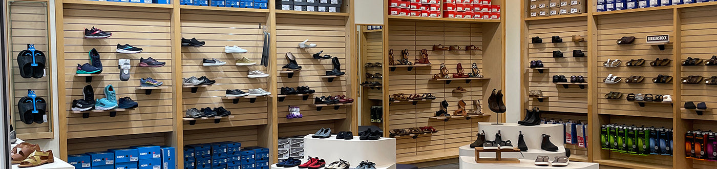 View from the of the store. Shoes displayed on the walls.