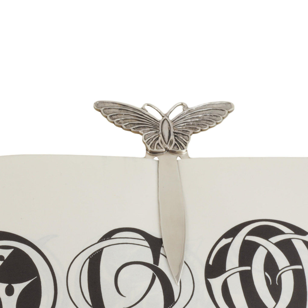 sterling silver butterfly bookmark on book
