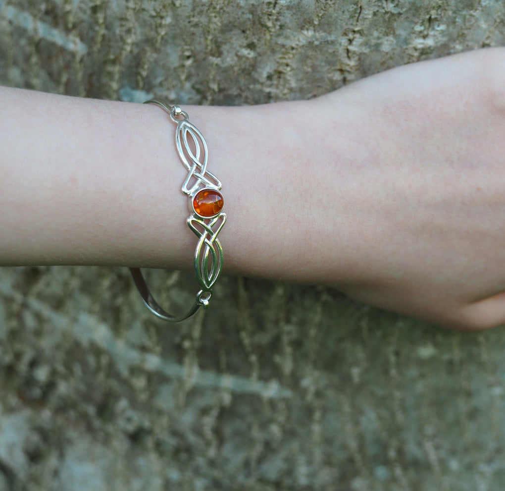 Personalised Sterling Silver Amber Bangle on models wrist