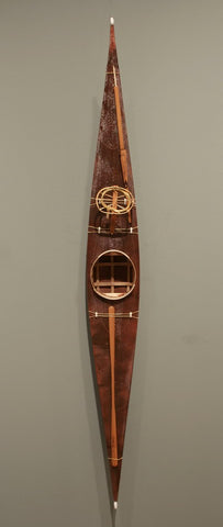 SKINNED KAYAK WITH HUNTING IMPLEMENTS