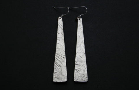 Sinx Earrings
