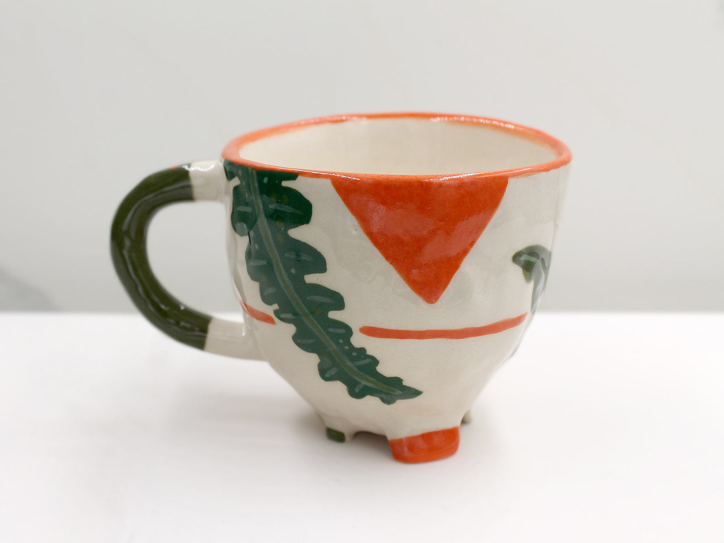 Palm and Triangle Mug with Olive Green Handle and Orange Detailing