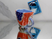 Load image into Gallery viewer, Blue, Red, and Orange Weirdo Mug