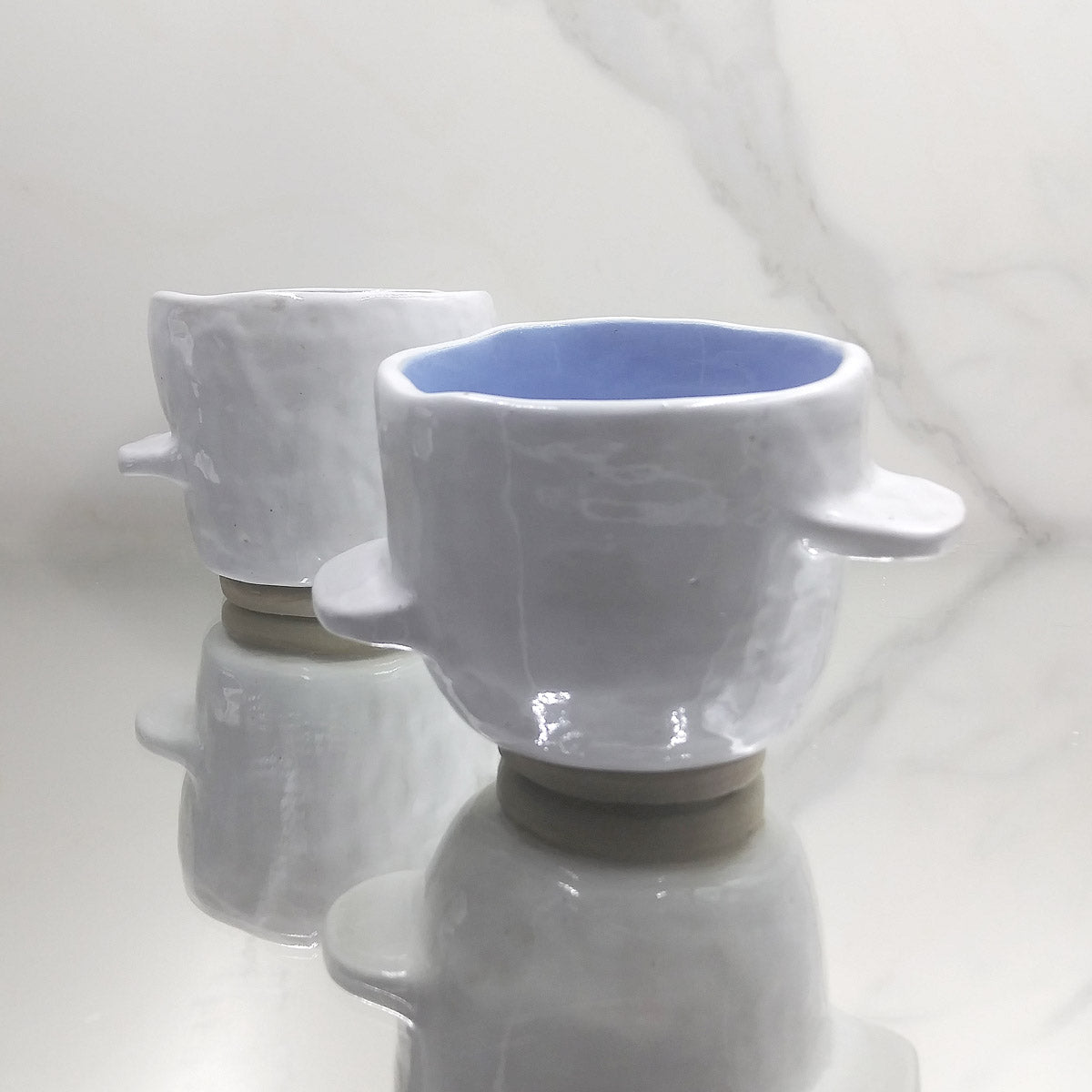 White Tabbed Cup with Blue Interior